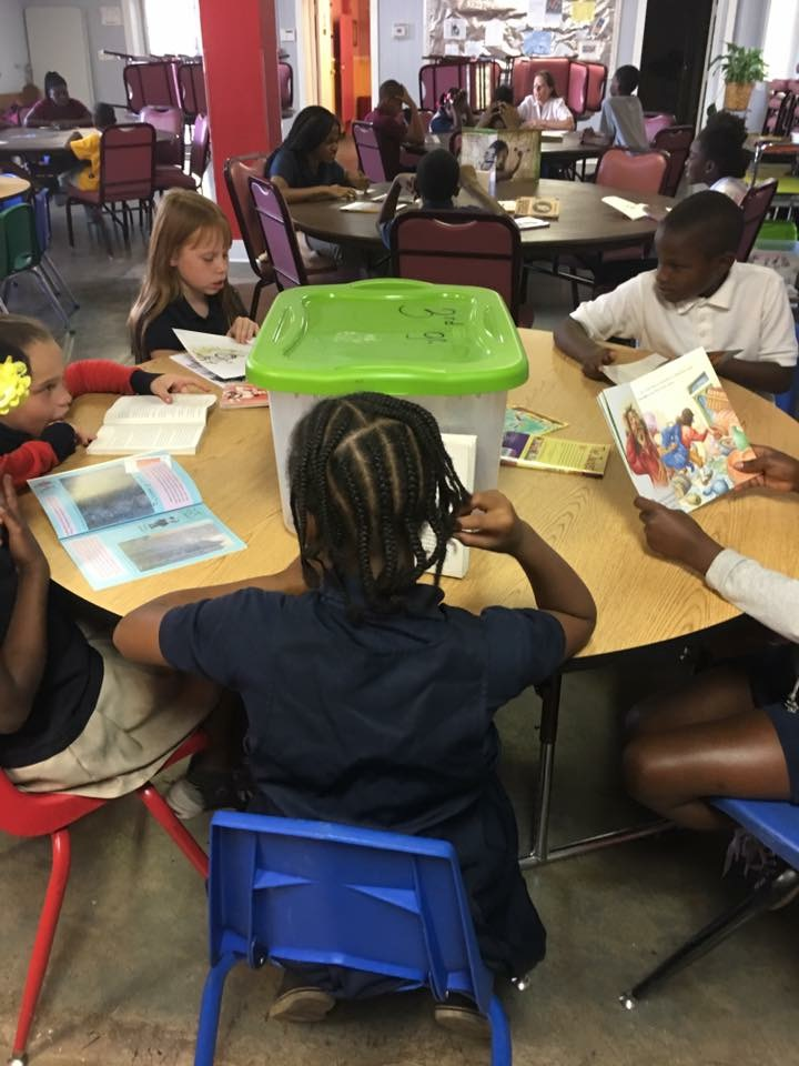 Students reading at a table.