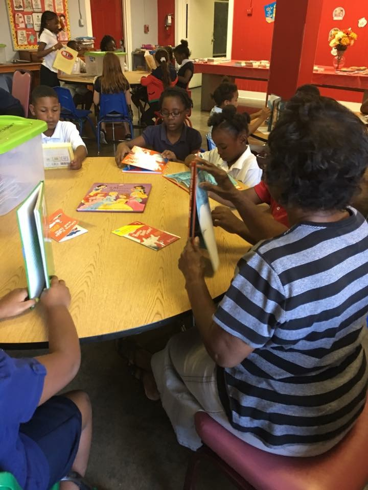Students reading with a mentor.