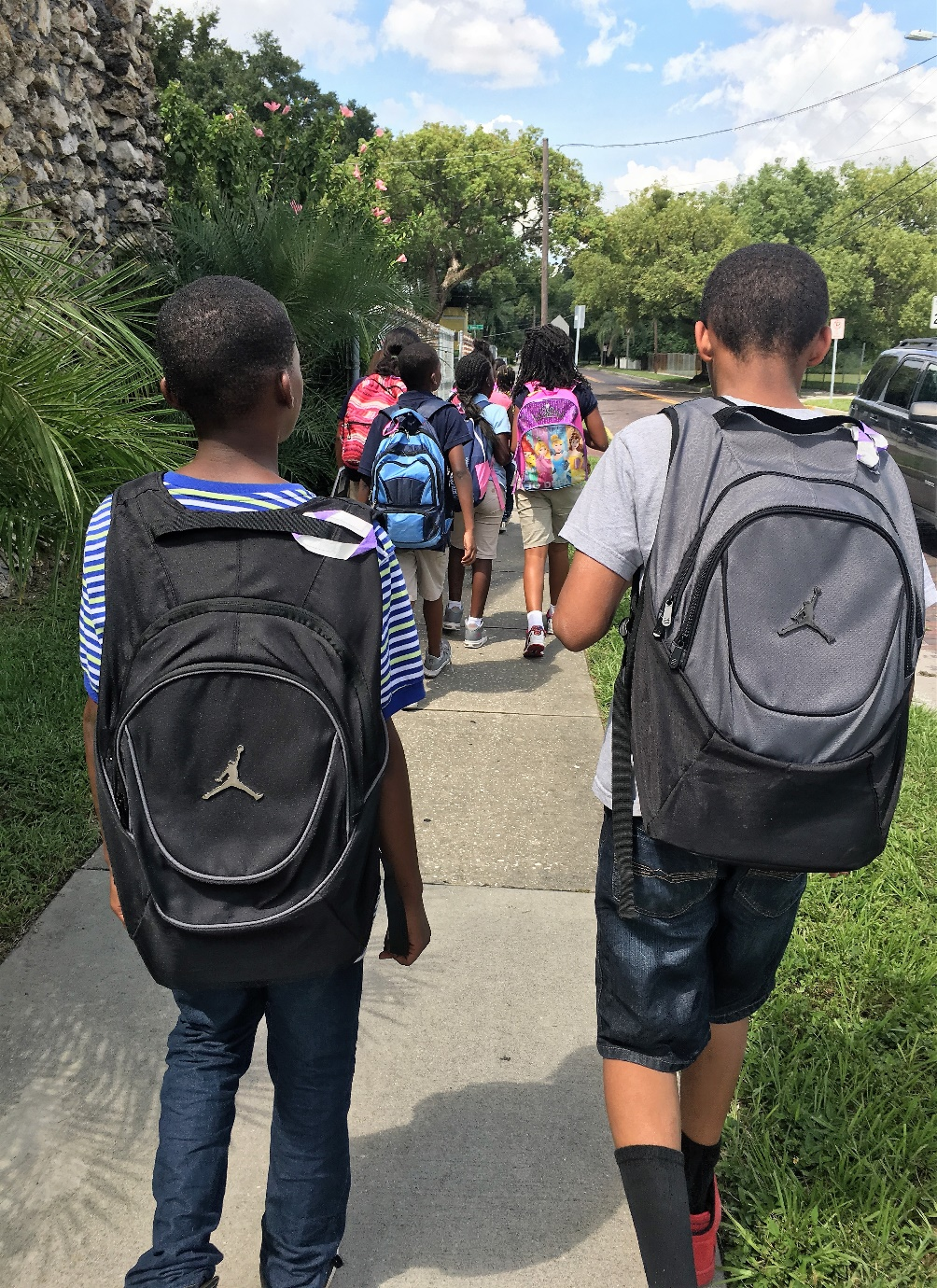 Students outside with backpacks.