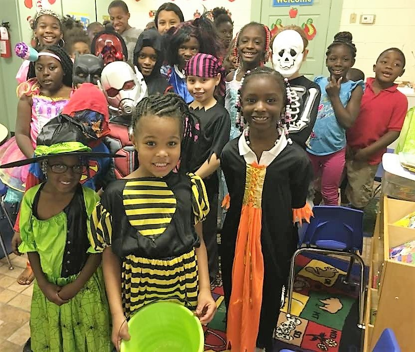Students in Halloween costumes.