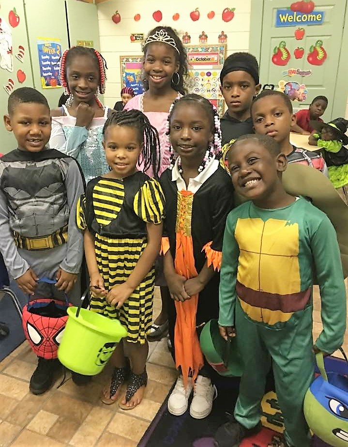 Group of students posing in halloween costumes.