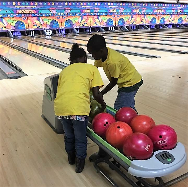 Students bowling.