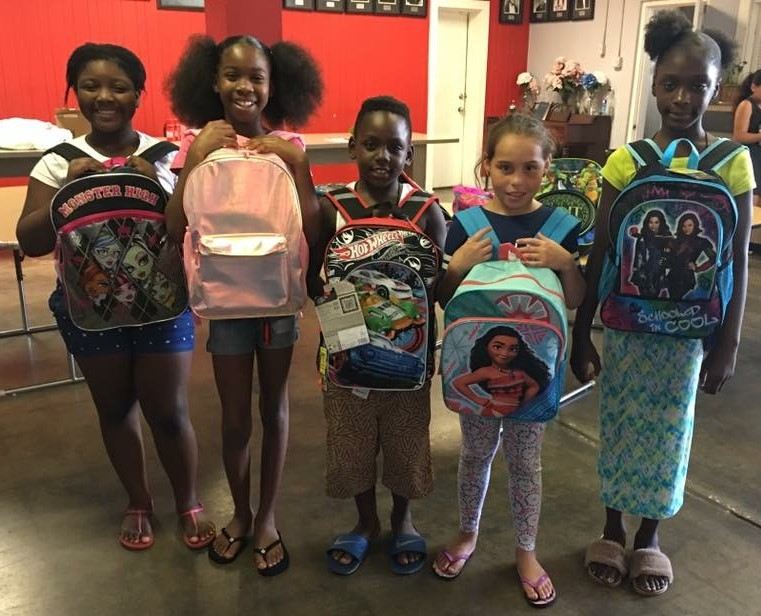 Students with backpacks.