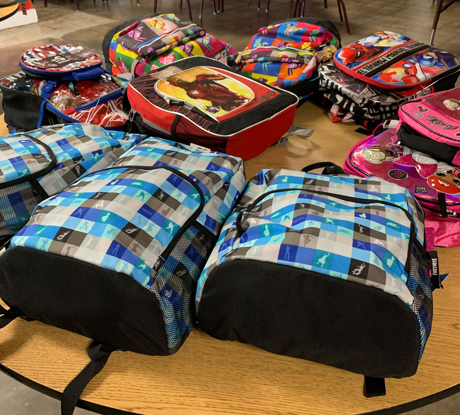 More backpacks on a table.