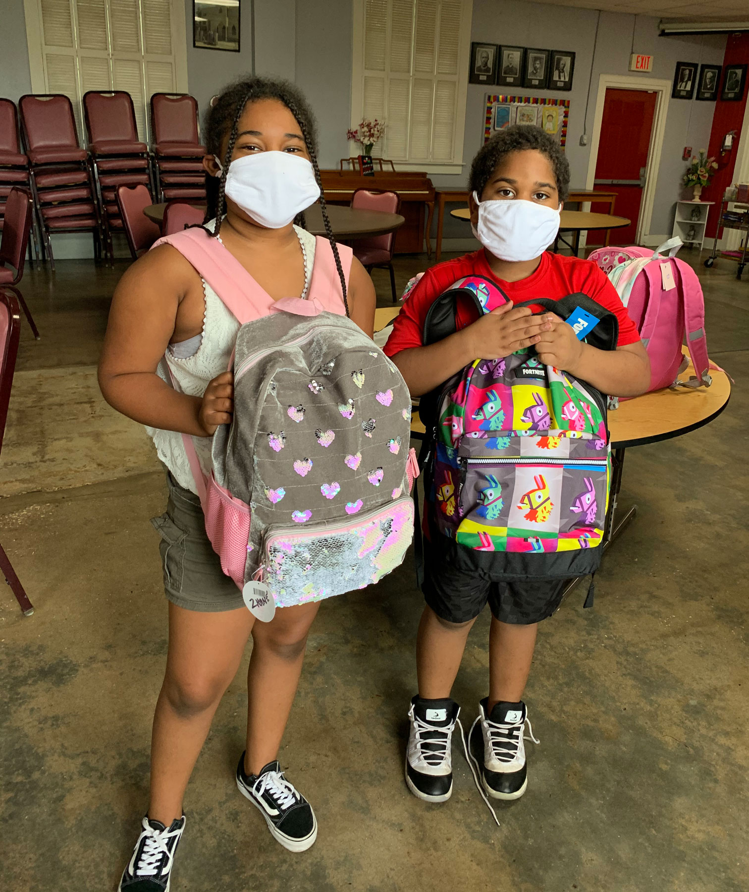Two students with backpacks.