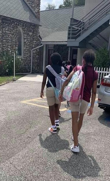 Students entering school.