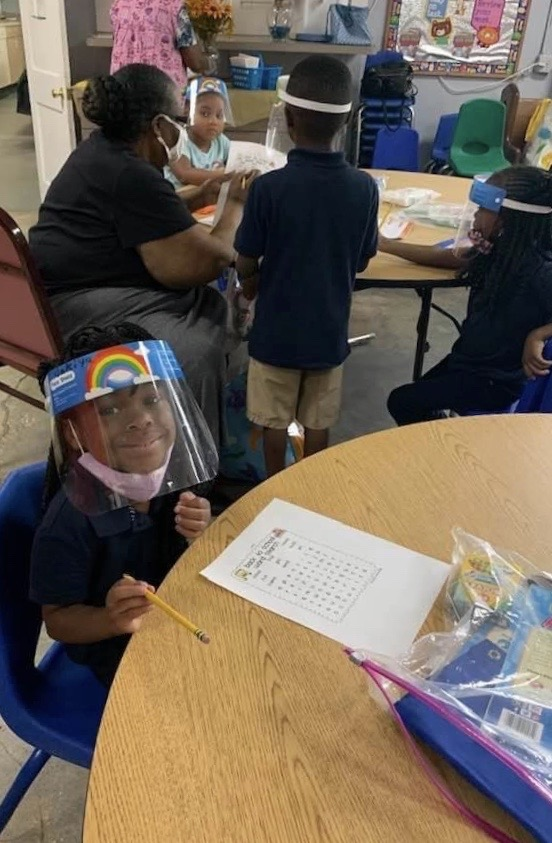 Students in class in face shields.