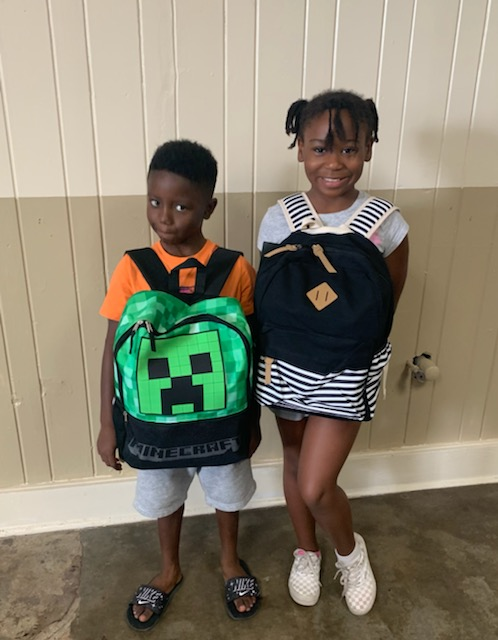 2 students with backpacks.