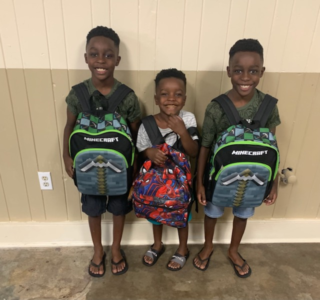 3 students with backpacks.
