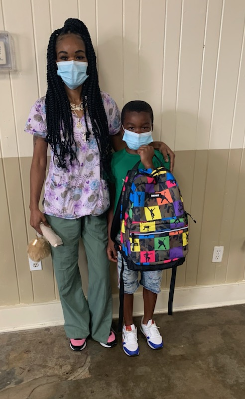 Parent and student with backpack.