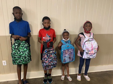 Four students with backpacks.